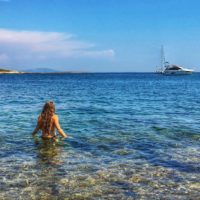 woman swimming in clear adriatic sea in cape kamenjak istria on croatia sailing adventure