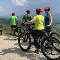 Cyclists and their e-bikes enjoying the view on a Croatia e-bike tour