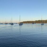 sailboats in a bay at sunset on croatia sailing adventure