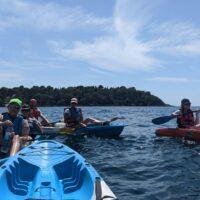 kayakers resting in the adriatic sea near a croatian island