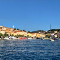 colorful houses and sailboats in the marina in mali losinj croatia
