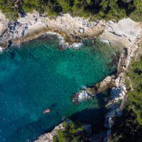 remote, rocky coastline with clear blue water near pula on croatia sailing adventure