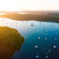 aerial view of sailboats next to green islands near pula on croatia sailing adventure