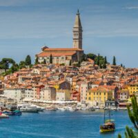 view of the colorful houses in Rovinj and the Adriatic Sea